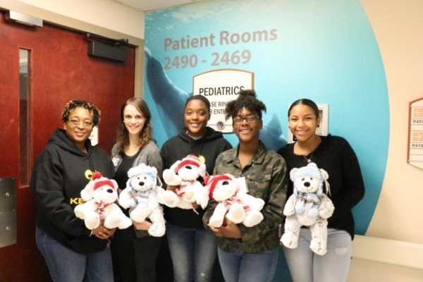 Group donating teddy bears